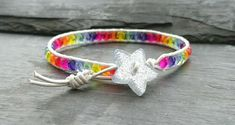 This colourful bracelet has been made with soft, metallic silver coloured cord. Faceted glass beads in all the colours of the rainbow have been added, and a glittery star shaped button has been used as a fastener. It will fit a wrist size of Faceted Glass, Glass Beads, Colorful Bracelets, Wrap Bracelets, Star Buttons, Organza Gift Bags, Star Shape, Leather Cord, Rainbow Colors