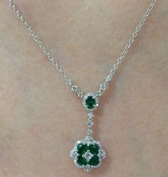 Emerald and diamond pendant with .68 cts of diamonds and .75 cts of emeralds.