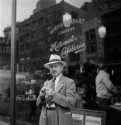 Stanley Kubrick - Man smoking a cigar in front of an automat. New York City, circa 1946.