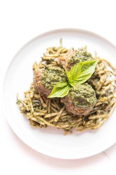 Whole30 + Keto Pesto Meatballs Recipe - 6g net carbs! Meatballs made with pesto, then topped with pesto and served on low carb noodles. Paleo, gluten free, grain free, dairy free, sugar free, clean eating, real food. #whole30 #keto #lowcarb