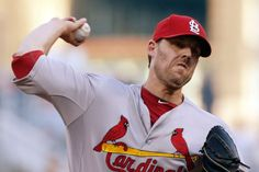 starting pitcher John Lackey throws against the Pittsburgh Pirates. Cards won 3-2. 8-25-14