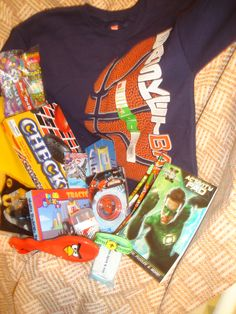 Some great ideas for Boys 10-14 on a $10 budget! Here's a collection for a boy 10-14 years old: sweatshirt ($2, Walmart), checkers ($1, Dollar General), notebook ($.50), pen  pencils ($.30), yoyo (0.75, Meijers), mini bricks ($0.50, DG), hairbrush ($1, DG), toothpaste with toothbrush ($1.19), deodorant ($0.50, Meijers), crayons ($.25), activity book ($0.12), bracelet ($0.12), candy ($1), hotel soap, Happy Meal toy=$9.23