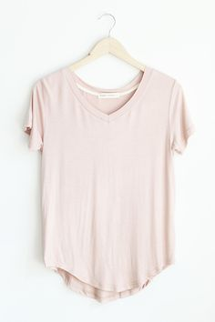 """- Details - Size - Shipping - • 95% Rayon 5% Spandex • Raw cut v-neck tee with rounded hem • Hand Wash • Line dry • Imported • Measured from small • Length 21""""front 25"""" back • Chest 17.75"""" • Waist 18."""