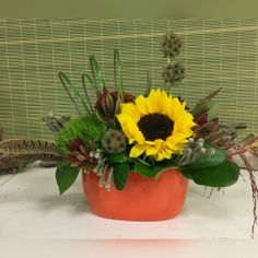 A sweet bit of fall in a keepsake orange ceramic container. Product may vary with availability .