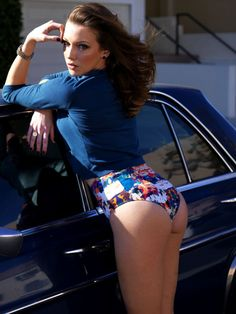 Katie Cassiby booty in a swimsuit leaning against a car