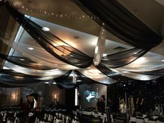 Las vegas casino night themed party - black and white swag ceiling with added fairy lights. All walls draped on our free standing framework also in black and white but with a full soft pleated coverage.