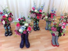 Flowers in wellies for this marquee wedding!