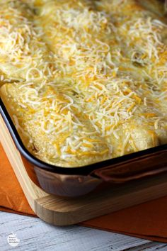 Cheesy Chicken Enchiladas Verde   by Renee's Kitchen Adventures - an easy dinner or lunch recipe for chicken enchiladas in green chili sauce with lots of CHEESE!