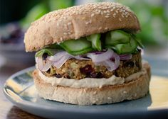 These flavor-packed veggie burgers with olives, chickpeas, and spices are at home whether they are in a burger bun, in a wrap, or served bunless.