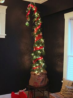 grinch christmas tree A Whoville Christmas from How to Make a Nine Foot Grinch Tree Grinch Christmas Tree Decorations, Grinch Trees, Large Christmas Ornaments, Wall Christmas Tree, Xmas Tree, Christmas Holidays, Christmas Crafts, Christmas Stuff, Homemade Christmas