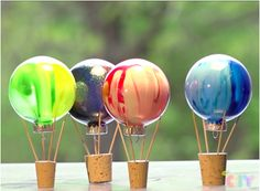 Create a colorful, painted hot air balloon with Crayola paints and clear holiday ornaments! Use metallic, neon or glitter Washable Kids Paint to give your balloon bright color and sparkle and set on the windowsill to decorate your space!