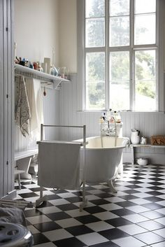 bathroom; window, tub, tiles (on the floor)