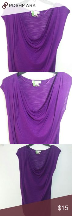 KENAR TOP Beautiful purple lightweight top.  Some what sheer but great for hot days.Can wear a cami or a sexy undergarment underneath. This beauty can be worn all yr round paired with a blazer, leather jacket, jean jacket  or as is.  Great unit piece also a wonderful pop or color. Kenar Tops Blouses