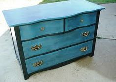Blue, black, and gold dresser