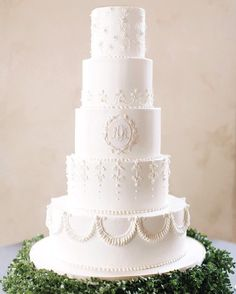 This all-white cake, by Simon Lee Bakery, was modeled after Prince William and Kate Middleton's wedding cake. It consisted of five tall layers, featuring the couple's monogram front and center and unique fondant appliqués on each layer.
