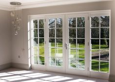 Hardwood French Doors With Applied Glazing Bars And Double Glazing.  Manufactured And Installed By Gowercroft Joinery.