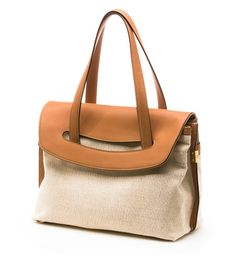 CLIPESTE | Stuart Weitzman Nappa and linen tote with gold hardware...for summer.