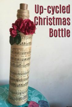 Up-cycled Bottle Christmas Song Sheet Decoration This upcycled wine bottle wrapped with sheet music is a great DIY Christmas decoration. Popsicle Stick Christmas Crafts, Christmas Crafts For Toddlers, Handmade Christmas Decorations, Diy Christmas Gifts, Christmas Décor, Christmas Recipes, Christmas Ideas, Recycled Glass Bottles, Decorative Bottles