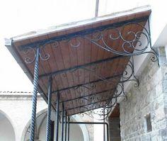 Tettoia con pilastri in ferro battuto attorcigliato | Pergolas ...
