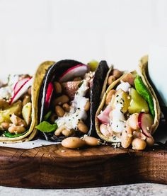 Topped with a garlic yogurt sauce, these vegetarian spring tacos with white beans and red potatoes are a healthy weeknight meal. Add avocado and hemp seeds for an added bonus! Healthy Taco Recipes, Healthy Weeknight Meals, Healthy Tacos, Potato Recipes, Gourmet Recipes, Mexican Food Recipes, Vegetarian Recipes, Radish Recipes, Avocado Recipes