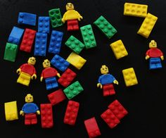 These 36 blocks in primary color are stock able and almost the size if a lego blocks. People/men are not included. Each topper is handcrafted