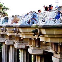 The mosaic covered wall around the elevated main terrace at Park Guell. Designed by Antonio Gaudi. Barcelona.