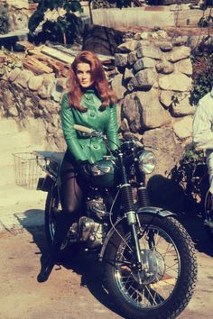 Ann-Margaret 1960's. Because she is a redhead, beautiful, and really rides motorcycles.