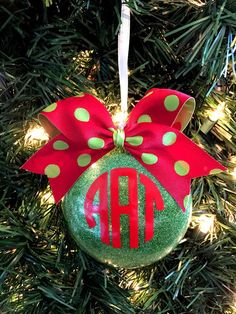 """Add a lot of sparkle to your Christmas tree this year! These shatterproof glitter ornaments are perfect for personalize your Christmas tree or giving as a gift! Think about teachers, coworkers, neighbors, family, friends, and secret santa gifts!These shatterproof ornaments are a large 4"""" wide and disk shaped in size. The glitter is on the inside, so no mess. All ornaments are topped with a substantial sized bow.**A monogram is typically structured with the last name as the l..."""