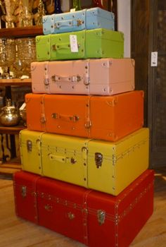 Photo from Raina Kattleson, from the Las Vegas Market.  Luggage from Go Home.  Love the colors, and I've always had a fondness for stacked pieces of luggage.