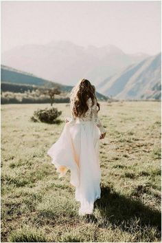Women's Bridal Dress DREAM: • Top: 3 Layers of stretch mesh, top layer is ivory covered with hand sewn lace pieces (may vary from photo), button and zipper back, long sleeve, button closure wrists. Dress photos are inspirational from Leann Marshall • Flowing Chiffon Skirt with
