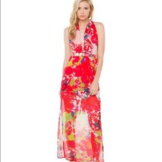 "Backless sexy floral maxi From the beach to the ballroom. The All Day Red Multifunction Dress features a banded elasticized waist, side slits, and a sleek maxi body with a plunging neckline on a halter-style top with extended straps that can be tied at back, wrapped around neck or waist. Lined. Pair this floor-length number with a box clutch & strappy sandals.   - 100% Polyester  - 46 1/2"" from waist to hem  - Straps: 79.5"" from hem to waist  - Hand Wash Cold  - Fits true to size  - Imported…"