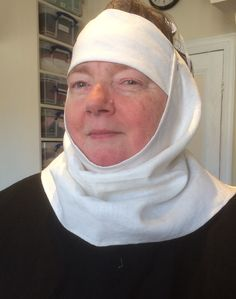 Benedictine nun, filet and wimple, white linen.