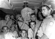 Brazilian soldiers of the Brazilian Expeditionary Force (Força Expedicionária Brasileira, or, FEB) return home aboard the Pedro II following the Allied victory of the Italian Campaign. The BEF was an...