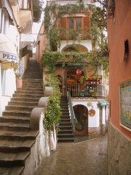 Love the European charm of this scene... makes me want to climb the stairs and turn the corner in search of the perfect cup of espresso.