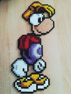 Wall decoration depicting Rayman. Ideal to color your walls. Made with pearls Midi. Ability to customize the template. The price varies depending on the model. Other models available upon request. Other listings in my shop. Feel free to contact me for a custom order. Enjoy your