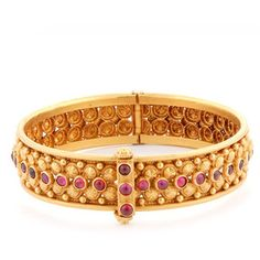 GOLD BANGLE STUDDED WITH RUBIES