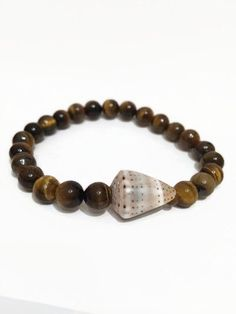 Hawaiian Cone Shell Bracelet Mens Stretch Bracelet Tigers Eye Beaded Bracelet for Men Hawaiian Cone Shell Mens Bracelet Mens Jewelry (ST58) by JulemiJewelry on Etsy https://www.etsy.com/listing/212491088/hawaiian-cone-shell-bracelet-mens