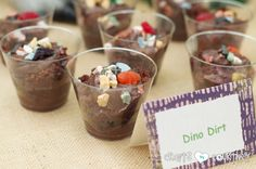 Dinosaur Birthday Party: Yummy Dino Dirt Snacks. Dirt dessert only with gummy Dino's instead of worms. Maybe in a cake pan too instead of individual cups..?