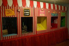 DIY Carnival Game Booths.  Made from cardboard boxes and covered with striped, plastic tablecloths.