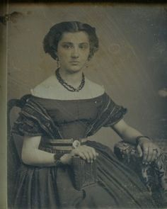 Unidentified young woman, seated, holding book. Daguerreotype by Thomas M. Easterly. Missouri History Museum