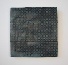"""THE DAILY PIC: This piece by avant-ceramicist Jeff Schwarz is on display at Revision Space in Pittsburgh, and may look at first glance like a patch of old kitchen tiles. It may look that way at second glance, too. What makes it work taking in, and thinking about, is only revealed if you give it a sidelong look in just the right light:Embedded in very shallow relief underneath the tiles' colored glaze is the barely discernible scrawl """"SCHWARZ IS A FAG"""". Those words apparently descend from…"""