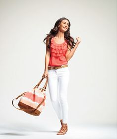 Love the color and ruffles on this top... and the matching bag!