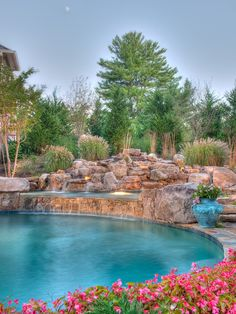 Swimming Pools Design by Lewis Aquatech | Boulder waterfall into spa pool | Swimming pool construction