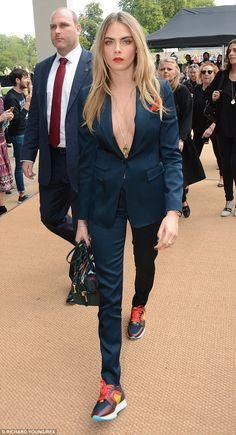 Gorgeous! Cara opted to go braless in a two piece navy suit which she teamed with a pair o...