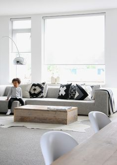 A pop of colour cushions for this monochrome setup. And maybe a more rectangular rug.
