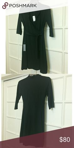 NWT Ann Taylor Faux Wrap Dress - Black NWT ❤ Ann Taylor Faux Wrap Dress - New With Tag! Never worn but has one button missing but attached in pouch. Side zipper. Size 10. Exceptional buy! Bundle with the Tahari plaid pants for a 20% discount! Ann Taylor Dresses