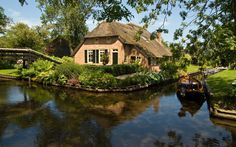 As you might have noticed from some of my pins, I'm fascinated by canal cities. holland waterway town