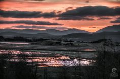 Early morning in the north of Scotland. The sun rises slowly over the highlands and deep puddles of rainwater reflect the red sky. Red Sunset, Beautiful Places In The World, Scottish Highlands, Landscape Photos, Early Morning, Countryside, Scotland, Sunrise, Landscapes