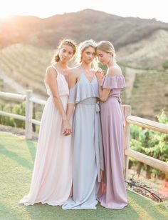 Joanna August // Cold-shoulder, off-the-shoulder and modern bridesmaid dresses in pastel hues - blush pink, pale misty blue, and light lavender