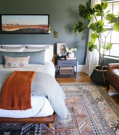 Bedside table lamps, a water carafe, a device charging station, a tray for precious jewelry and coins, an alarm clock on the nightstand, and a small waste basket are all great touches. And make certain to leave lots of wall mounts in the closet for hanging clothes. #greenbedroom